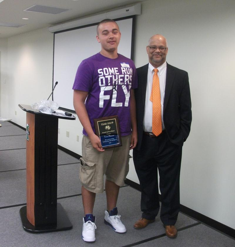 ... Cabell County Schools Superintendent William Smith presented an award  to Huntington High student Tevin Thomas for ...